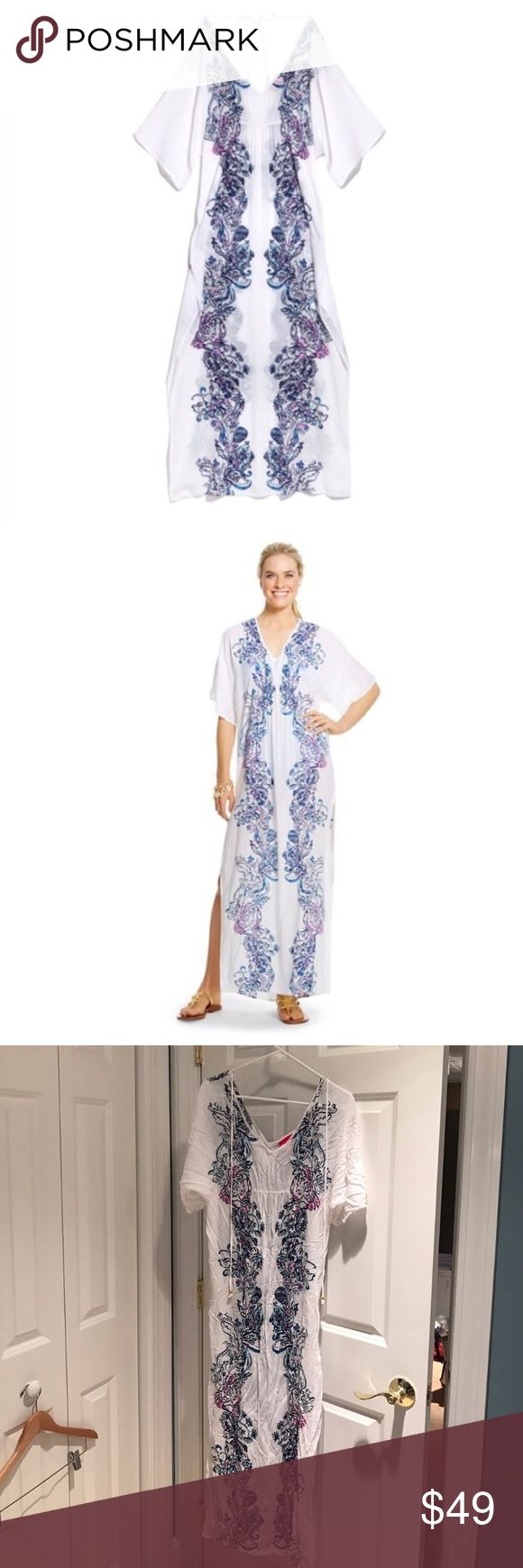 Lilly Pulitzer for Target Caftan/Beach Cover Up XS Lilly Pulitzer for Target Caftan/Beach Cover Up XS.  This one is sold out everywhere. Near new condition this one was washed once but never worn.  Runs large. Would fit up to probably a size medium. Lilly Pulitzer for Target Swim Coverups