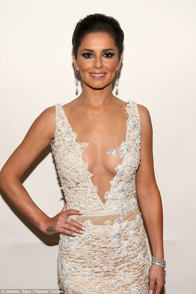 Bridal chic: at the Xfactor 6/12/14 ivory gown Cheryl Fernandez-Versini's wedding earlier this year have surfaced. But giving an idea of how she would look walking down the alter, Cheryl wowed on Saturday's X Factor in an awe-inspiring gown.