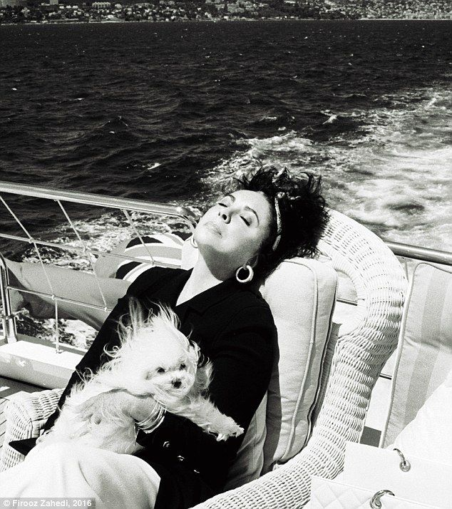 YES SHE CANNES Elizabeth Taylor napping on a friend's yacht near Cannes in 1993 with her Maltese Terrier Sugar, her constant companion, who died in 2005