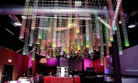 Bring neon flair to ceremony backdrops, place settings, escort cards, cakes and more.
