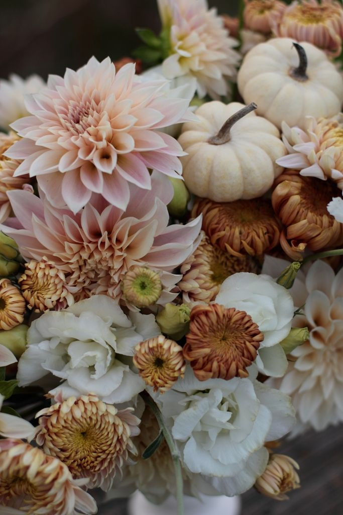 Centerpiece in muted autumn hues of cream, bronze, taupe, and blush with baby…