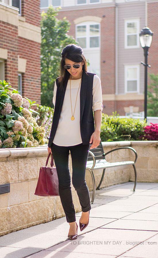 black vest, cream faux leather yoke top, black pants, raspberry purple tote, dark red pumps