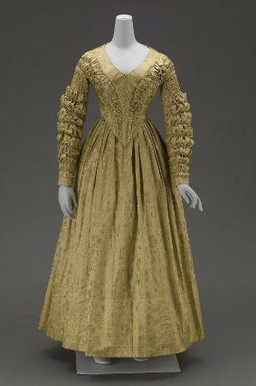 Gold silk satin dress with ruffled sleeves. c. 1840