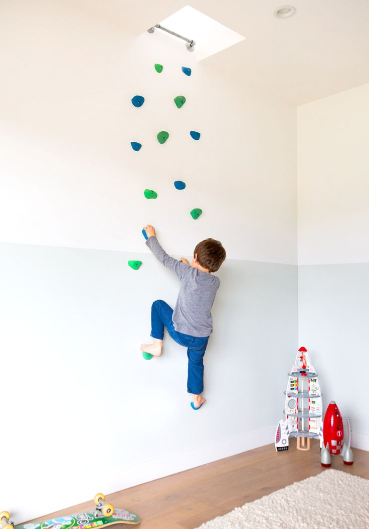 "Home Tour: A Modern Family's Custom Hillside Home via @MyDomaine One of the more unique elements in the home is the custom climbing wall in their son's room. ""It leads to the upstairs living room,"" Cleo tells us about the unusual inclusion. ""We designed secret entrances for both of the kid's rooms. Our daughter has a passageway under the stairs into her closet."""
