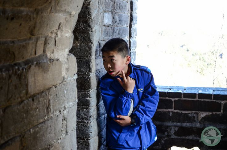 Chinese boy waiting for his friend at the Great Wall  #china #travel #photography #portrait
