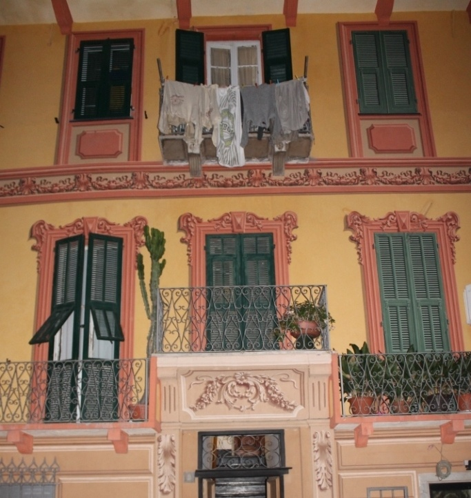 Beautiful building in Loano richly decorated with trompe l'oeil frescoes. Clothes hanging up to dry are real!...