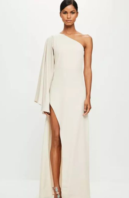 this nude maxi dress features a one shoulder style with long sleeve, extreme seam split and maxi length.