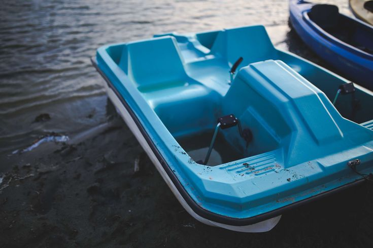 #beach #blue #boat #daylight #empty #holidays #lake #leisure #ocean #outdoors #pedalo #plastic #recreation #sea #seat #summer #transportation system #travel #vacation #vehicle #water #watercraft #wo