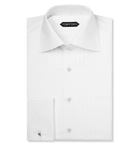 White Pleated Cotton Tuxedo Shirt | MR PORTER, Sharpen up your eveningwear with this TOM FORD tuxedo shirt. The crisp white cotton style features a pleated front and sophisticated double cuffs, making it ideal for teaming with fine formal accessories. Choose a silk bow tie for a distinguished finish, a wee bit over priced at $780.00 but after all it is TOM FORD I need not say anything else.....RR