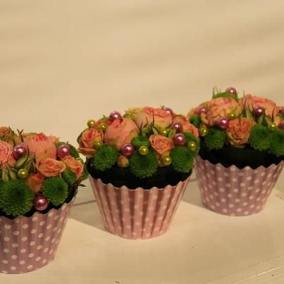 www.alfabridal.com  .What a cool idea to have running down the center of your table, floral cupcakes!!  Could even be favors!!