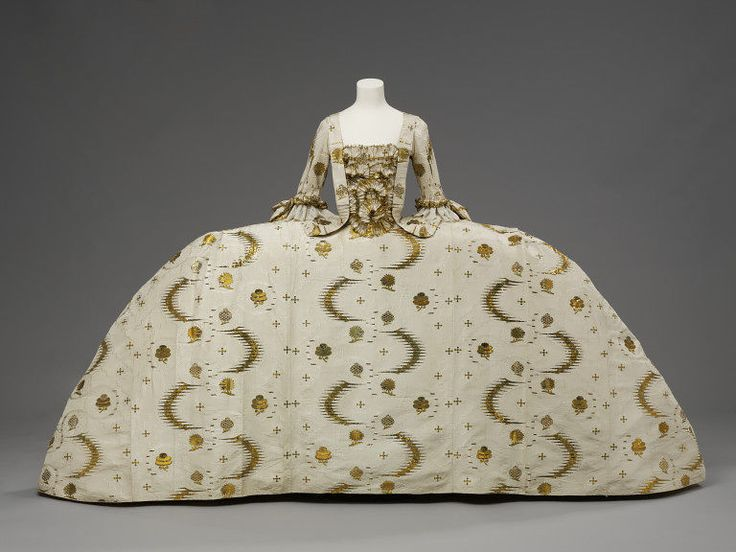 "1755-1760 British Mantua at the Victoria and Albert Museum, London - From the curators' comments: ""Although considered stylish daywear in the early 18th century, the mantua had become very old-fashioned by the 1750s and was worn only for court dress. Wide hoops were beginning to go out of style, but kept their extreme width at court. To make up for its conservative cut, court dress was always made from the most fashionable as well as expensive fabrics and trimmings."""