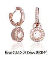 Kagi - Rose gold orbit drops to finish your outfit.