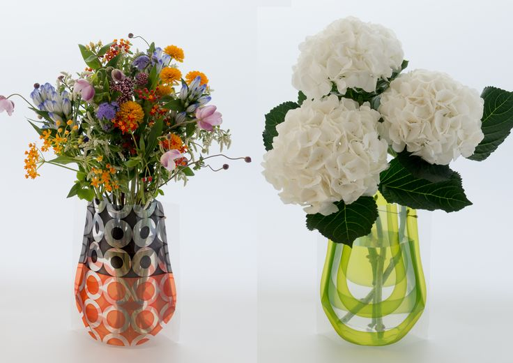 「Hope Forever Blossoming」 (Large)  A large version of our acrylic sleeve flower vase lends itself to generous flower arrangements.  Reinforced acrylic material affords added stability and strength; a brass support makes it easier to position flowers. Attractive sleeve-type packaging enhances gift appeal.