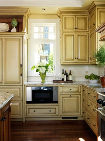 Butter Yellow-love the color              Yellow cabinets seem to go with everything. Try them paired with cream and red, green and black, or blue and white. Aged and distressed cabinets will have a vintage or Tuscan feel to them
