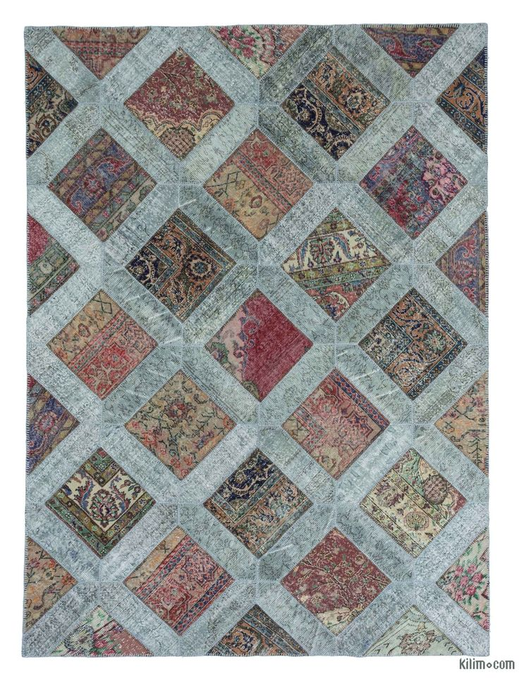 This piece is an over-dyed Turkish patchwork rug created by first neutralizing the colors and then over-dying to achieve a contemporary effect and bring old hand-made rugs back to life. The result is almost like an abstract painting. This piece is backed with cotton cloth as reinforcement.