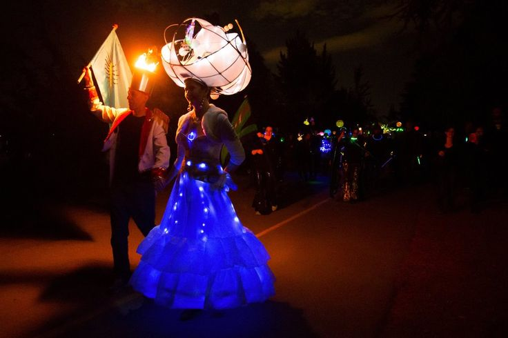 Peter Toms and Marina McDonagh walk in the Luminata lantern parade, which is held annually at Green Lake on the evening of the autumnal equinox. (Erika Schultz/The Seattle Times)