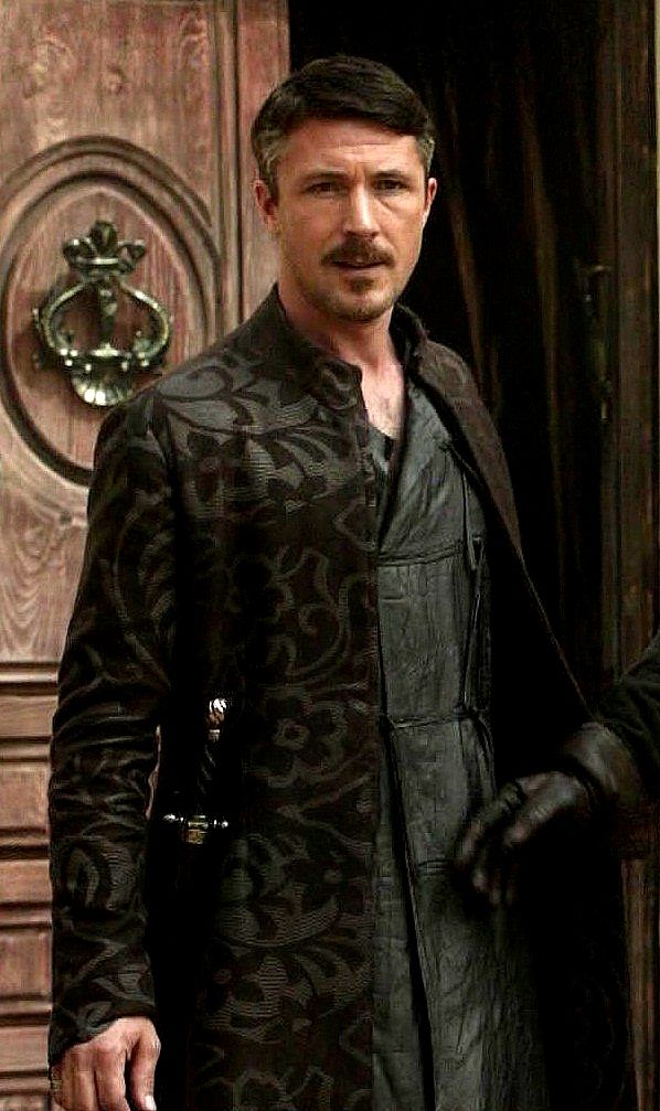 Is it just me or does petyr look like he is wearing a dress in this photo ?