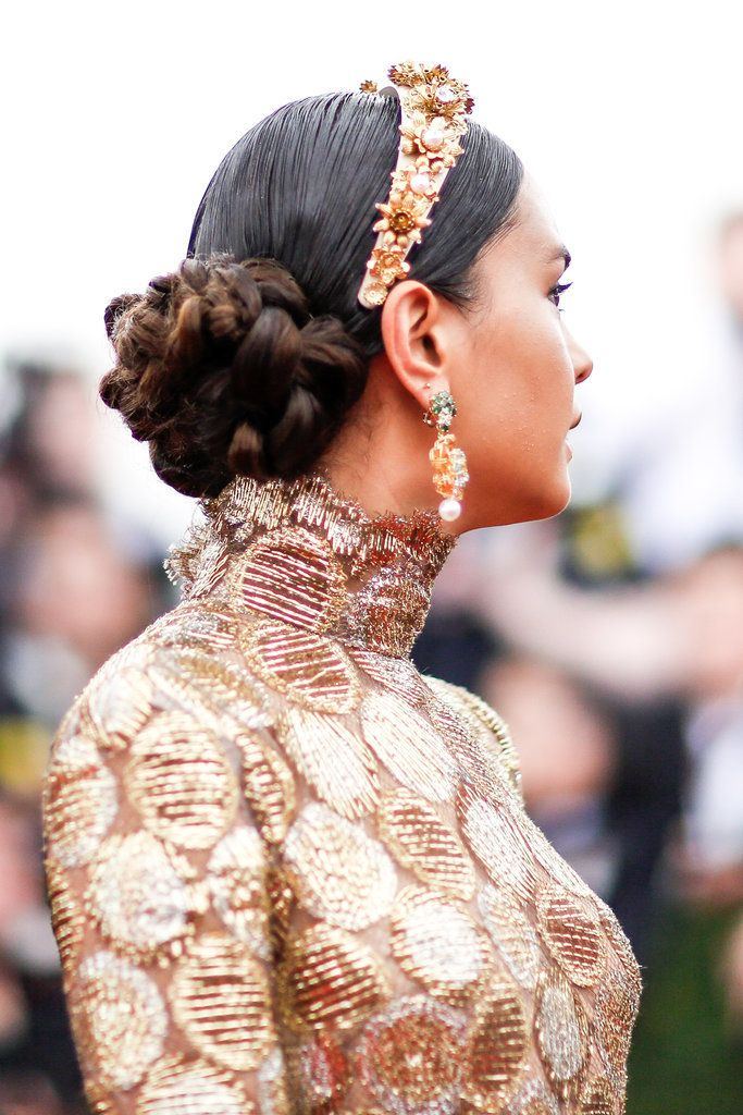 We don't know what we love more — Courtney Eaton's updo or her Dolce & Gabbana headband.