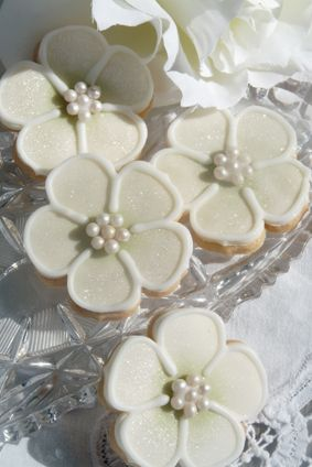 Green Flower £3.00 The perfect gift, favour or place setting. Beautifully decorated to compliment your theme, cookies are available in lemon, vanilla or slightly spiced. Bagged and tied with ribbon to match £3.95