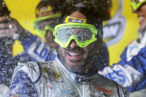 Jimmie Johnson Photos Photos - Jimmie Johnson, driver of the #48 Lowe's Chevrolet, celebrates with his team in Victory Lane after winning the NASCAR Sprint Cup Series Ford EcoBoost 400 and the 2016 NASCAR Sprint Cup Series Championship at Homestead-Miami Speedway on November 20, 2016 in Homestead, Florida. Johnson wins a record-tying 7th NASCAR title. - NASCAR Sprint Cup Series Ford EcoBoost 400