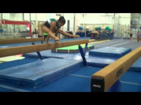 advanced conditioning on the beam jump rope on beam, jumps over beam, bhs drills, press hs, v-ups under and on the  beam, rocks on beam