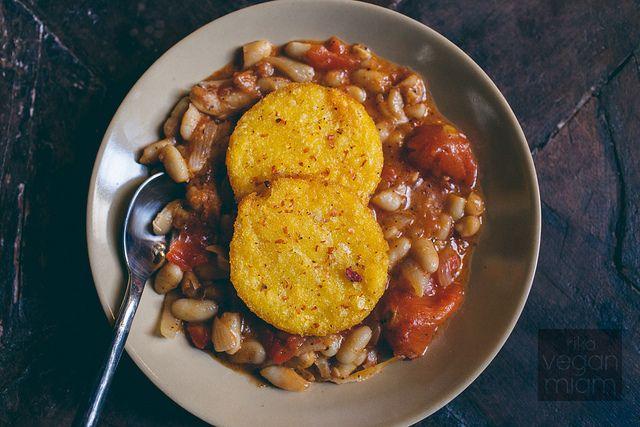 Tuscan White Bean Stew topped with Crispy Polenta Medallions | vegan miam
