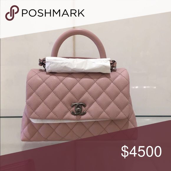"""Chanel 17C Pink Coco Handle Medium Gorgeous baby pink color & very rare. Medium size (dimensions listed below). This is the new version of the coco handle where the strap is removable. Made out of calfskin with ruthenium hardware. ONLY ONE AVAILABLE!!!! ><"""" Comes with full box and gift receipt. Will only negotiate with serious buyers!!! Last pic is of the bag that I have, brand new with packaging still intact!!! Cheaper on Tr adesy or ️️!!! CHANEL Bags Shoulder Bags"""