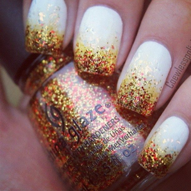 Gold/orange glitter nails maybe with a purple nail instead of white to match wedding colors
