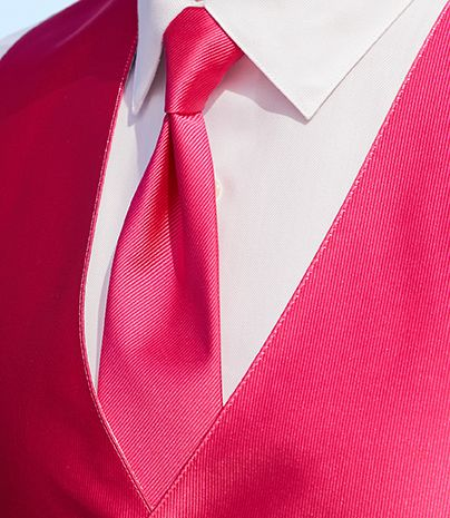 A pop of pink is great for a bright summer wedding. #menswearhouse #tuxedos #weddings