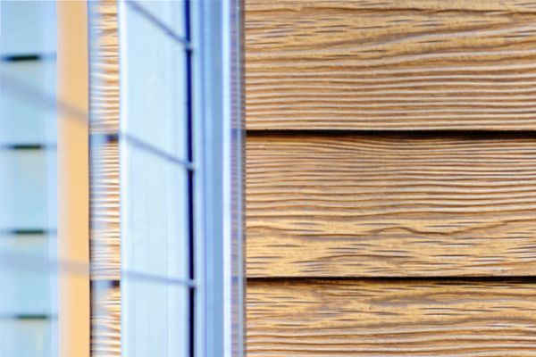 RusticSeries contemporary wood look siding on Allura Fiber Cement in Summer Wheat. Beautiful modern look with metal accents.