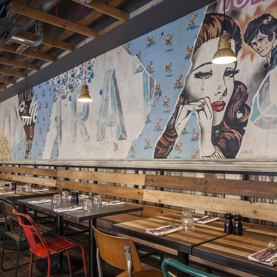 Different areas offer customers a variety of experiences depending on whether they are popping in for a coffee or sitting down for a full-on feed, but throughout salvage is at the forefront, with scaffolding planks for seating booths, tiles from a church – even the loo cubicle doors were something else in a former life...