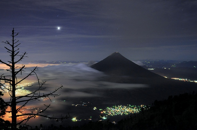 While Guatemala Sleeps...  View of Volcan de Agua, taken from Volcan Acatenango. The bright lights in the top left are Guatemala City. Below that are the lights of Antigua.