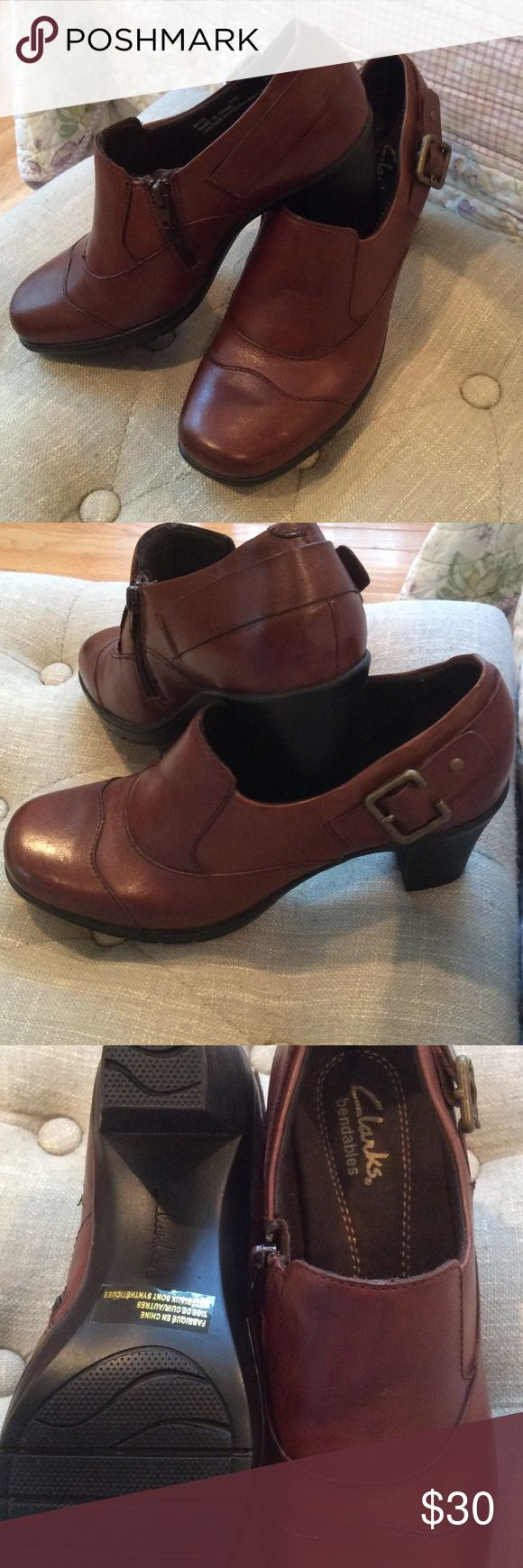 """Clarks Bendables Shoe Boots NWOT They are basically NWOT because they were tried on just inside the house.  The color is brown, not a deep dark brown and not a tan brown either.  I face sometimes they can take on a burgundy hue as well depending on the lighting.  Size is 61/2M.  They are comfortable and bendable.  About a 2"""" thick heel.  Has some nice traction on the bottom of them also.  Zipper is real but not needed to slip them on.   The buckle on the side is just for decoration.  No box…"""