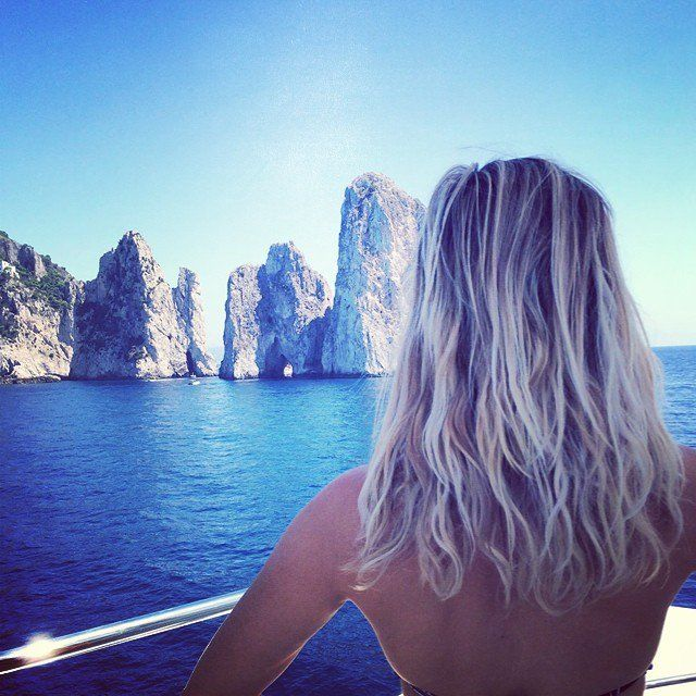 Pin for Later: Reese Witherspoon's Instagram Will Make You Fall in Love With Her All Over Again  Reese gave us major beach-hair envy when she posed on vacation.
