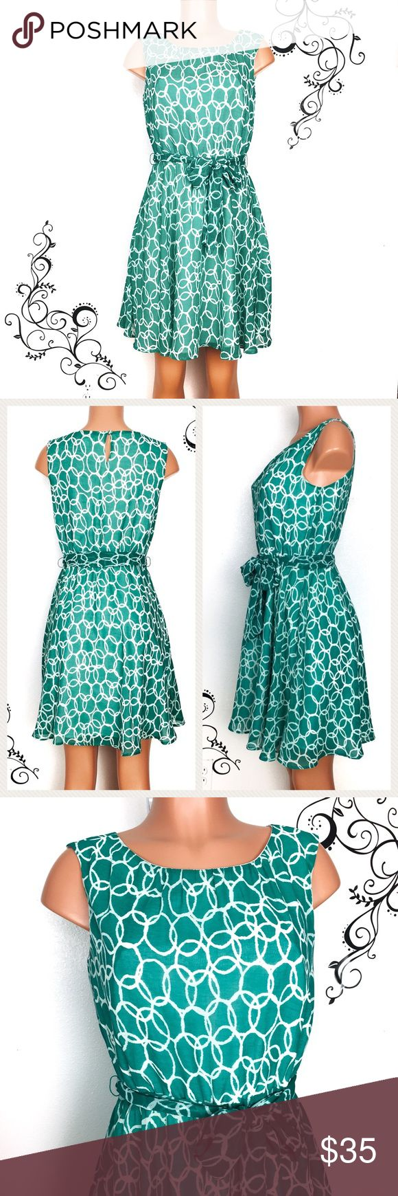 """BANANA REPUBLIC circle print green chiffon dress Really cute circle print fit and flare sleeveless dress from Banana Republic.  Has matching sash tie, keyhole button on back, light flowy chiffon fabric, fully lined.  Perfect for work or any special occasion.   Condition: nwot, no visible flaws found, excellent condition.  Size:6P Chest: 17 inches across  Waist: stretches 14-18"""" Length: 35"""" Fabric: polyester  🚫trade Banana Republic Dresses"""