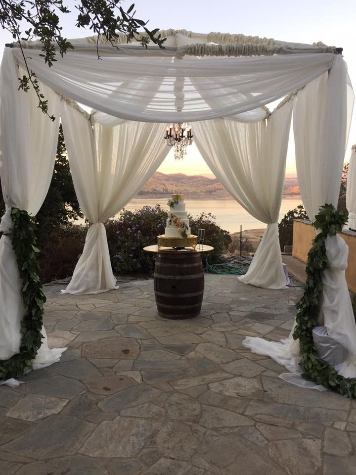 Make a statement with your wedding cake. 10x10 tent frame, ivory socks on the poles, sheer drapery and chandelier.  The design possibilities are endless. Visit www.exporentals.com for more ideas. #WeddingsbyCassandra