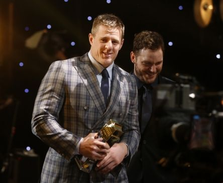 J.J. Watt, of the Houston Texans, left, accepts the AP defensive player of the year award on stage with Chris Pratt at the 4th annual NFL Honors at the Phoenix Convention Center Symphony Hall on Saturday, Jan. 1, 2015. (Photo by Colin Young-Wolff/Invision for NFL/AP Images)
