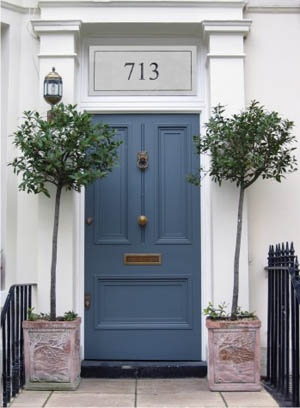Fantastic front door with number etched above.