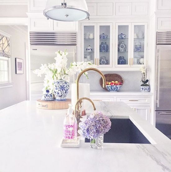 White kitchen and purple flowers