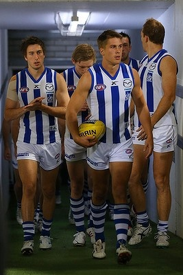 Andrew Swallow of the Kangaroos leads his team onto the field.West Coast versus North Melbourne,May 17,2013.