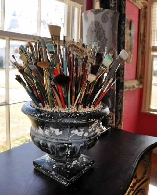 Use an old garden urn as storage... would also be great for cooking utensils. (Upcycle plastic bins, or plastic window boxes from dollar store?l.t.)
