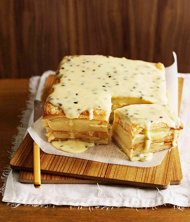 Australian Passion Fruit Vanilla Slice. Puff pastry layered with custard, topped with passion fruit icing.