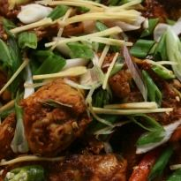 Spicy Tangy Kadhai Chicken Recipe - Chicken cooked in spices, jaggery and tamarind. It is absolutely lip smacking.
