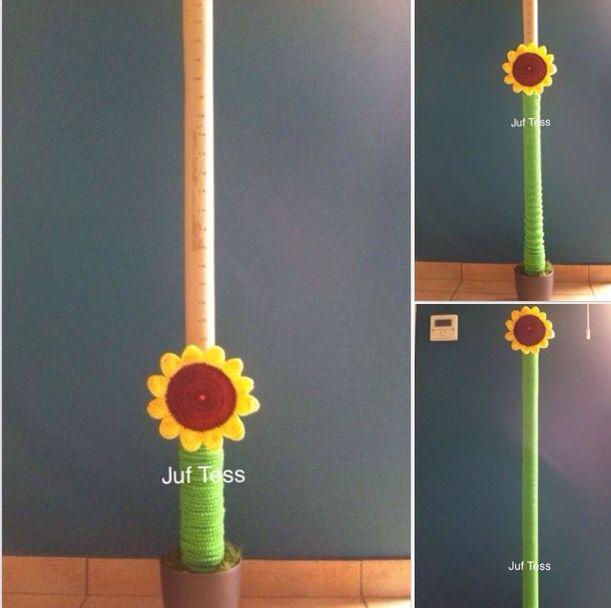 Scorebord of klassikaal beloningssysteem. De kleine bloem kan groeien. Juf Tess.