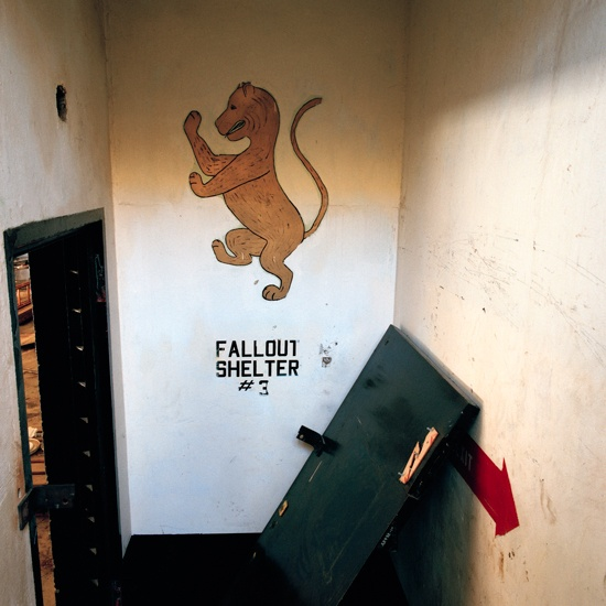 Jeff Brouws, After Trinity (1987-1988)  Nike Missile Silo 6, logo at entrance to anti-ballistic missile silo / fallout shelter looking west toward Los Angeles, Mt. Gleason. California (1987)