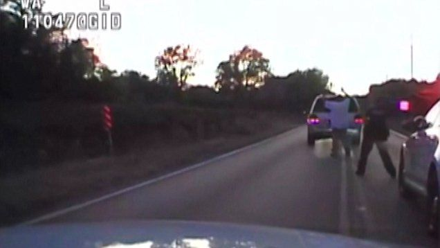 Unarmed black man is shot and killed by police in Oklahoma while raising his hands in the air. Officer charged with 1st degree manslaughter, I think it should be a murder charge, 5 cops there, his hands are up! smdh