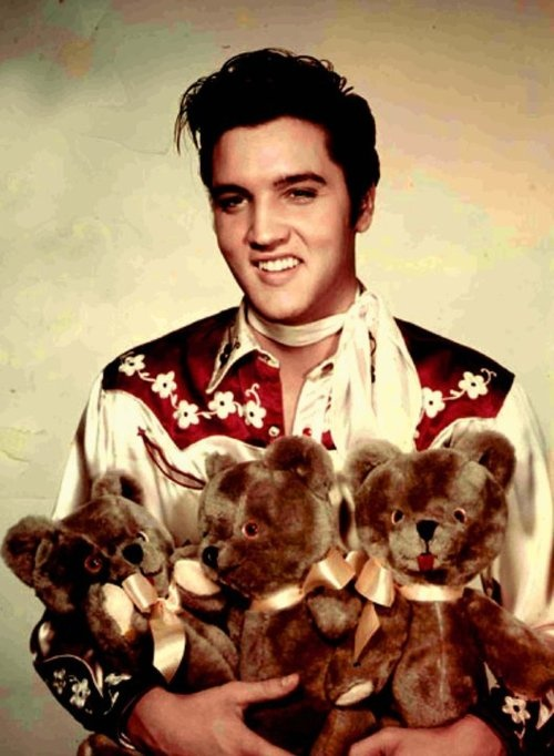 """Publicity photo: Elvis in """"loving you""""; song: Teddy Bear."""