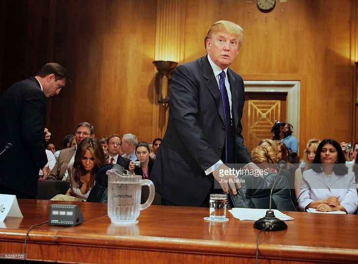 Donald Trump, president of the Trump Organization, takes his seat as he prepares to testify before the Federal Financial Management, Government Information, and International Security Subcommittee Capitol Hill July 21, 2005 in Washington, DC. Trump's wife Melania Trump is seated at left. The hearing was held on the topic of 'U.S. Financial Involvement in Renovation of UN Headquarters.'  (Photo by Joe Raedle/Getty Images)