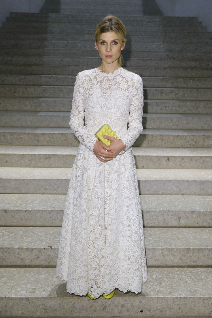 Clemence Poesy wears a Valentino gown from the Spring/Summer 2014 collection and Valentino Garavani clutch and shoes from the Spring 2014 collection at the event hosted by Mytheresa for Valentino at the Neues Museum on December 4th 2013 in Berlin