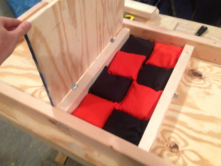 Bag storage underneath the Cincinnati Bengal corn hole board. Check www.facebook.com/fishscustoms for more and custom order information.